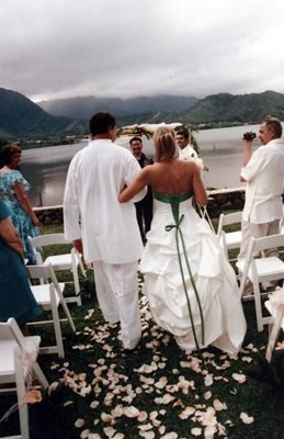 Dad walkin Cassidy down the aisle in Hawaii